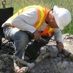 a geological field engineer testing water flow in soil layers